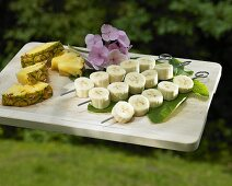 Banana kebabs and pineapple pieces ready for barbeque