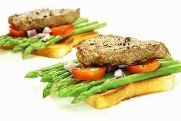 Toast with asparagus and beef steak