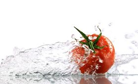 A tomato surrounded with water