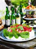 Strawberry cake on buffet table in garden (Sweden)