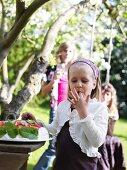 Children at buffet in garden (Sweden)