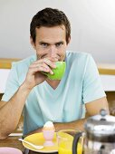 Man drinking coffee at breakfast table