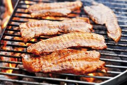 Marinated belly pork on barbecue
