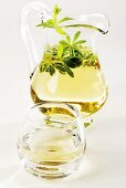 Woodruff punch in glass and glass jug