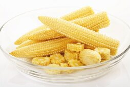 Baby corn in glass bowl