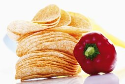 Potato chips and bell pepper, close-up