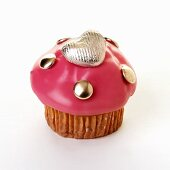 Muffin with pink icing and chocolate heart