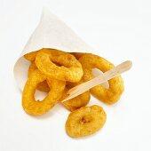 Fried calamari-rings in paper bag