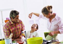 Parents with daughter (6-7) in kitchen