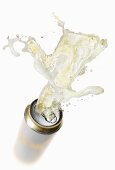 Beer splashing out of can