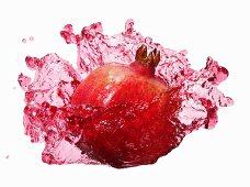 Pomegranate with splashing pomegranate juice
