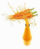 Carrot juice splashing out of bottle
