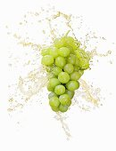 Green grapes with splashing juice