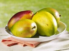 Several mangos on plate