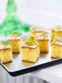 Squares of orange cake with fresh mint