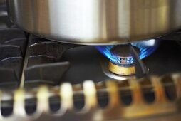 Burning flame on a gas stove (close-up)