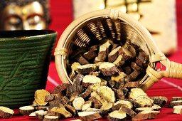 Dried Ural liquorice root in tea strainer for making tea