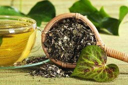 Dried ivy in tea strainer with tea
