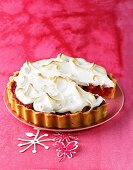 Rhubarb meringue tart on a red plate