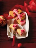 Nougat hearts with pink icing sugar and candied rose petals