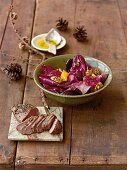 A winter salad with wild duck breast
