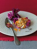 Lamb and red cabbage wrap with onion sauce and lentils