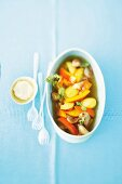 Potato soup with pumpkin, peach, pork and marjoram
