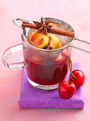 Cherry and almond punch with cinnamon, star anise and cherries