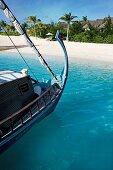 Traditional boat Dhoni at the coast of Dhigufinolhu island resort in Maldives