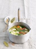 Fish, prawn and vegetable stew in a saucepan