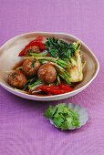 Stir-fried meatballs on a bed of spicy vegetables