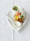 A baked potato with vegetable quark, chives and pepper