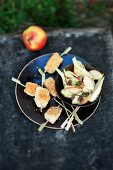Zander skewers with an apple medley
