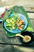 Chicken skewers with an avocado salad