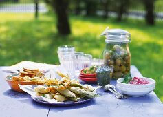 Various side dishes for a summer party on a table in a garden