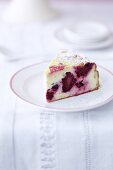 A slice of blackberry cheesecake on a plate