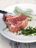 Argentinian steak being marinated with herbs and olive oil
