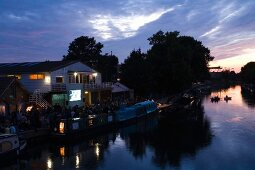 View of  Stamford Hill, Floating Cinema and river Lee in East End at dusk, London, UK