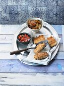 Crispy fried fish with tomato salsa and rosemary potatoes