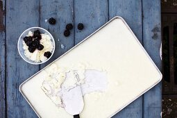 Homemade buttermilk ice cream on a tray with blackberries