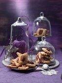Plates of pecan nut biscuits under glass cloches