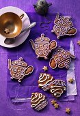 Decorated gingerbread biscuits shaped like teapots and cupcakes