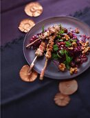 A cabbage dish for the winter: salad with red cabbage, walnuts and chicken
