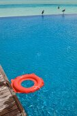 Red rubber ring at pool in Dhigufinolhu island resort, Maldives