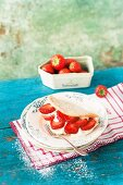 Sponge cake omelette with cream and strawberries