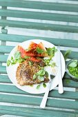 A pork chop with grilled watermelon