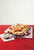 Marzipan crumble cake with cherries and blackberries