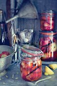 Peaches with vanilla syrup in preserving jars