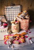 Coconut and pineapple macaroons and honey cake in paper bags
