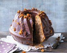 Chestnut Bundt cake with red wine and dark chocolate glaze, sliced